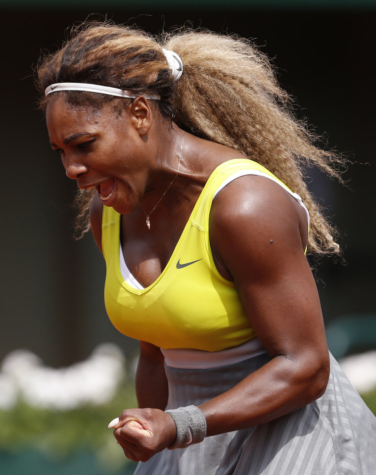 Photo - Serena Williams of the U.S, reacts shortly before defeating France's Alize Lim during the first round match of  the French Open tennis tournament at the Roland Garros stadium, in Paris, France, Sunday, May 25, 2014. Williams won 6-2, 6-1. (AP Photo/Darko Vojinovic)
