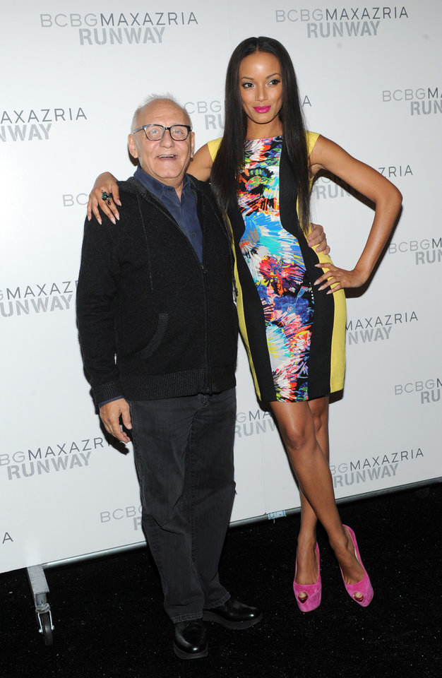 Photo -   Designer Max Azria poses with model Selita Ebanks before the BCBG MAX AZRIA Spring 2013 collection is shown at Fashion Week in New York, Thursday, Sept. 6, 2012. (Photo by Diane Bondareff/Invision/AP Images)