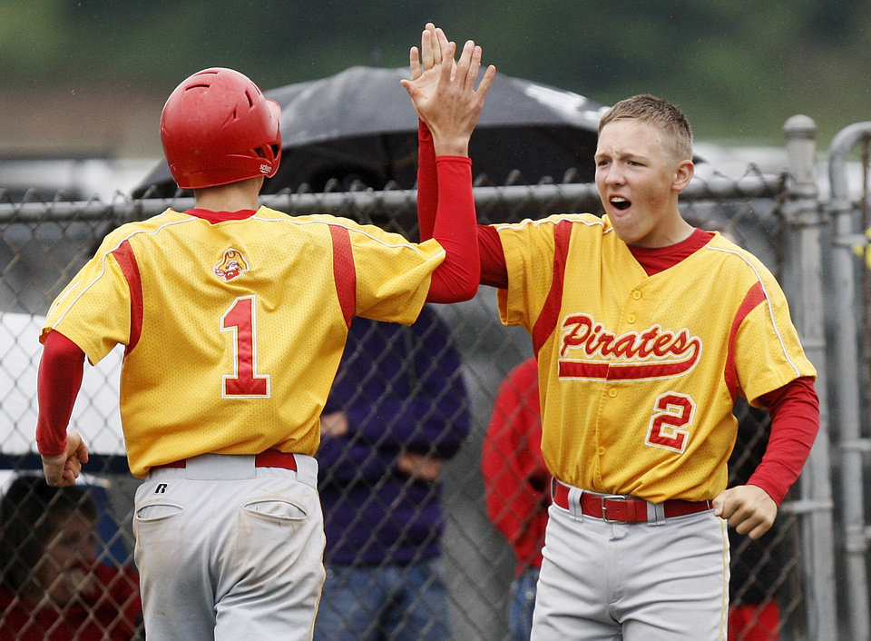 Photo - Dale's Chase Byndas (2) celebrates with Gunnar Hathcock (30) after Hathcock scored in the third inning during a Class 2A state high school baseball championship semifinal game between Dale and Tushka at Palmer Field inside Dolese Park in Oklahoma City, Friday, May 11, 2012. Photo by Nate Billings, The Oklahoman