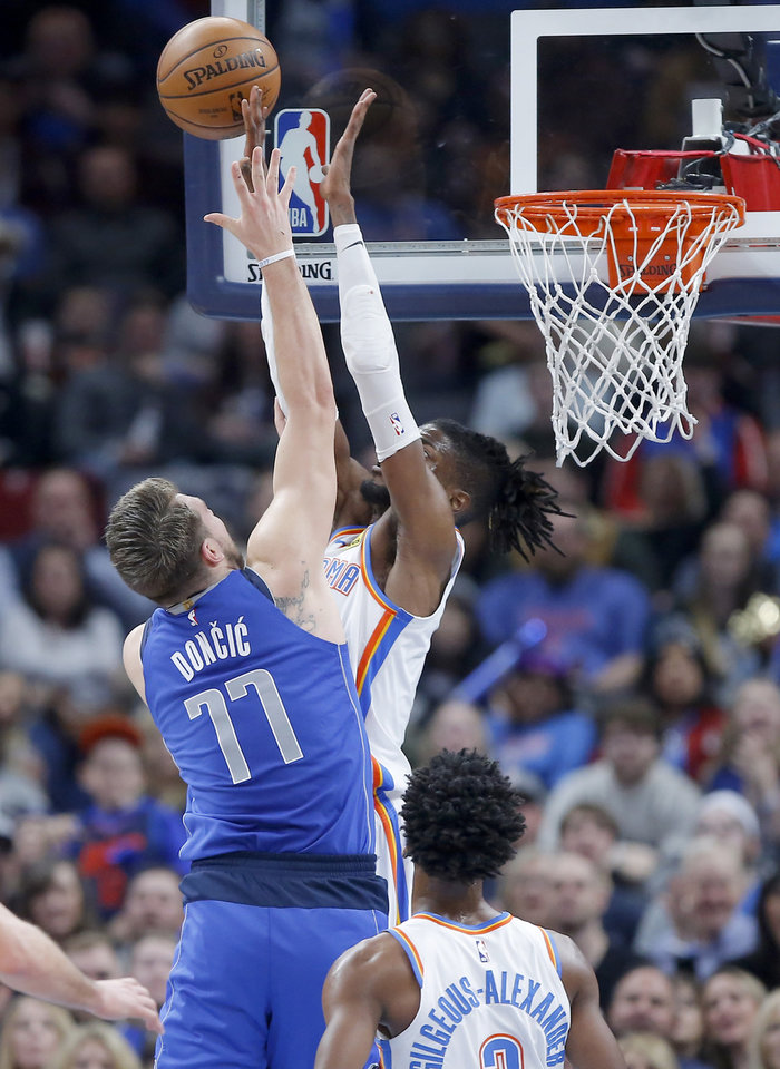 Photo - Oklahoma City's Nerlens Noel (9) blocks the shot of Luka Doncic (77) of Dallas during an NBA basketball game between the Oklahoma City Thunder and the Dallas Mavericks at Chesapeake Energy Arena in Oklahoma City, Tuesday, Dec. 31, 2019. [Bryan Terry/The Oklahoman]