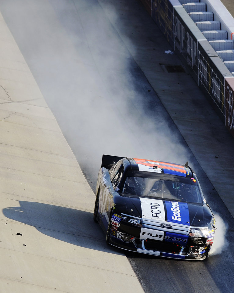 Matt Kenseth drives his damaged car down the front stretch during a NASCAR Sprint Cup Series auto race, Sunday, Sept. 30, 2012, at Dover International Speedway in Dover, Del. (AP Photo/Nick Wass)