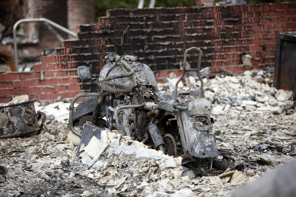 George Reich\'s motorcycle his home was destroyed by wildfire on Blackjack Lane in Edmond, Okla., Sunday, Aug. 7, 2011. Photo by Sarah Phipps, The Oklahoman