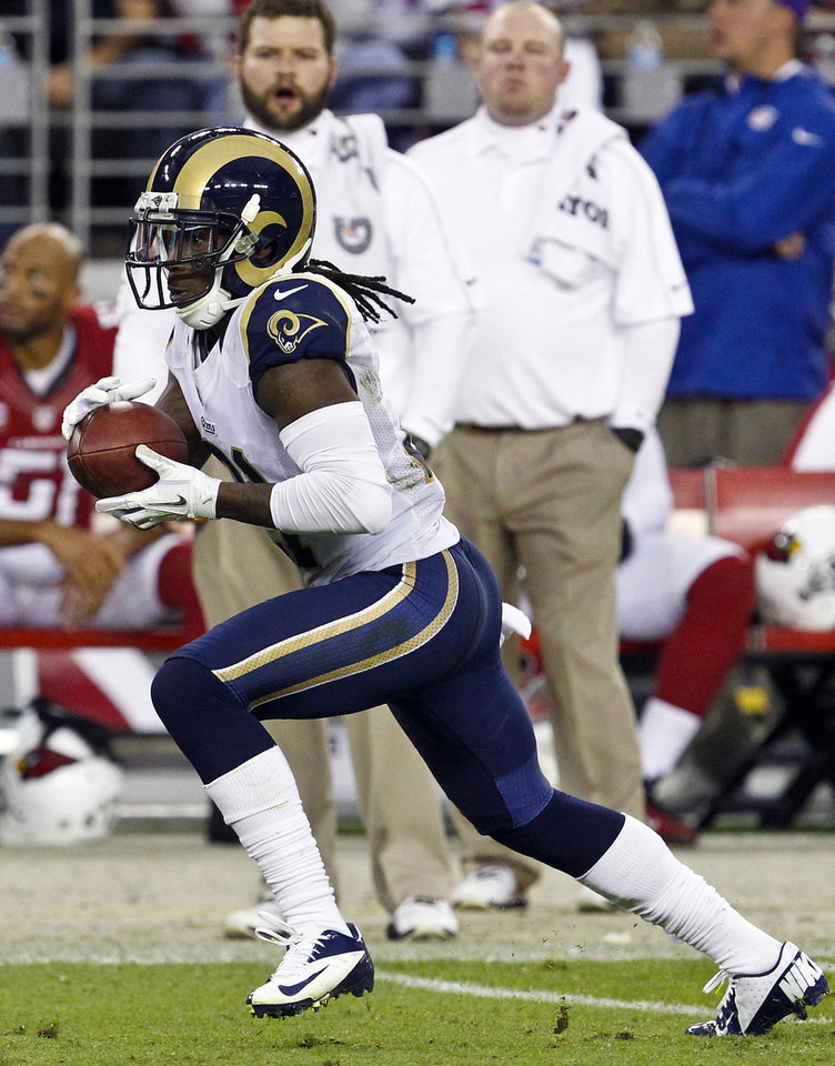 Photo -   St. Louis Rams' Janoris Jenkins hauls in his second interception on his way for a second touchdown during the second half in an NFL football game against the Arizona Cardinals, Sunday, Nov. 25, 2012, in Glendale, Ariz. The Rams won 31-17. (AP Photo/Ross D. Franklin)