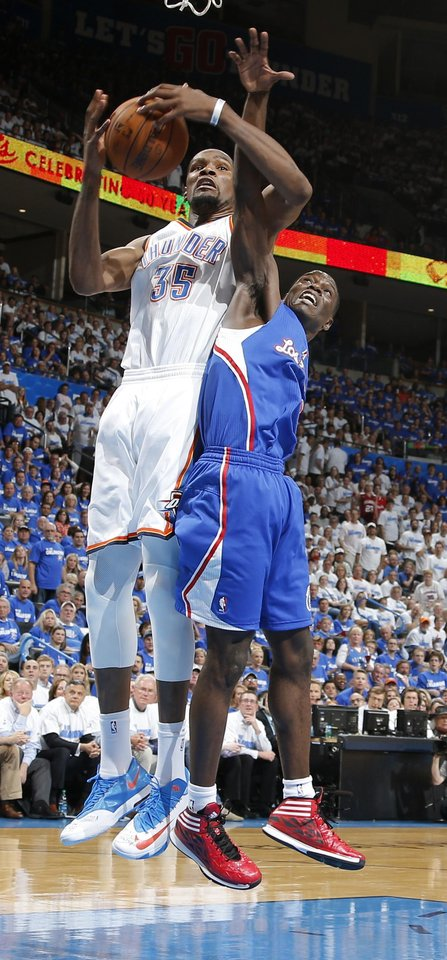 Photo - Oklahoma City's Kevin Durant (35) grabs a rebound over Los Angeles' Darren Collison (2) during Game 2 of the Western Conference semifinals in the NBA playoffs between the Oklahoma City Thunder and the Los Angeles Clippers at Chesapeake Energy Arena in Oklahoma City, Wednesday, May 7, 2014. Photo by Bryan Terry, The Oklahoman