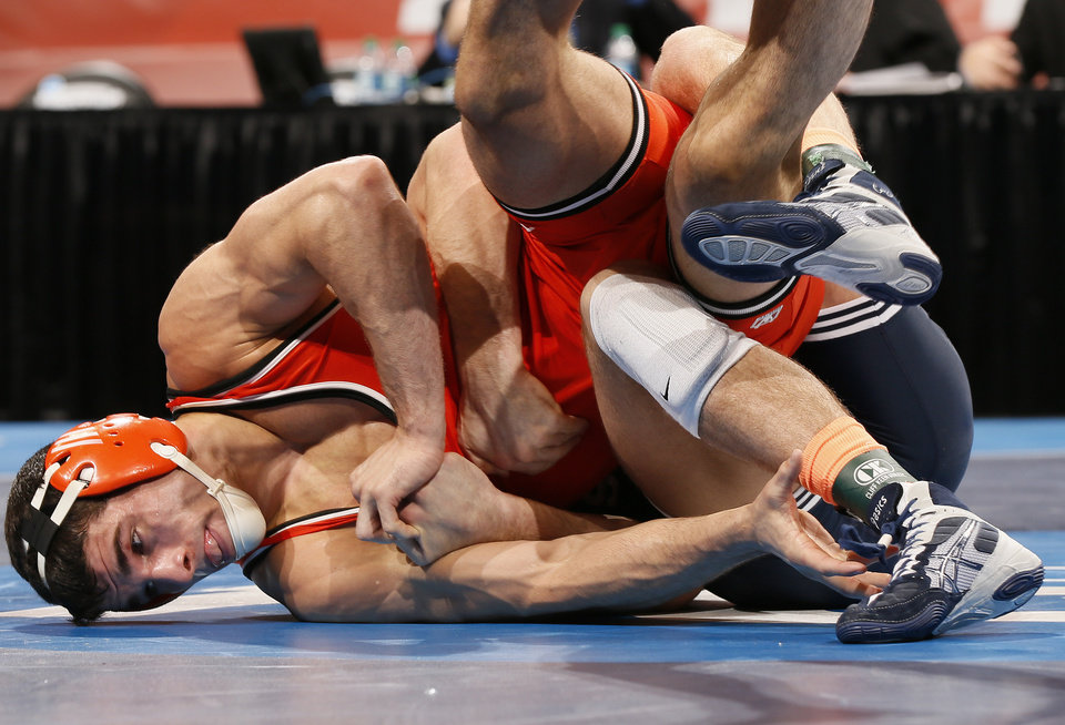 Photo - OSU's Tyler Caldwell wrestles Penn State's David Taylor at 165 pounds in the 2014 NCAA Div. I Wrestling Championships at Chesapeake Energy Arena in Oklahoma City, Saturday, March 22, 2014. Photo by Nate Billings, The Oklahoman