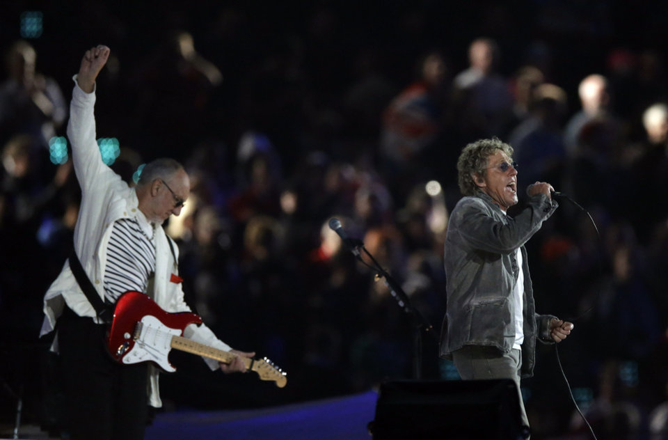 Photo -   The Who guitarist Pete Townsend, left, and singer Roger Daltrey perform during the Closing Ceremony at the 2012 Summer Olympics, Monday, Aug. 13, 2012, in London. (AP Photo/Matt Slocum)