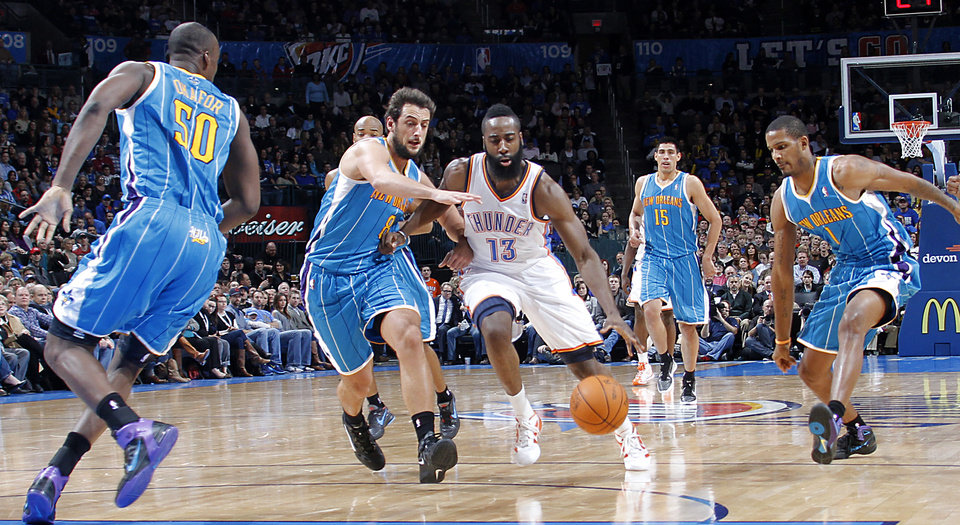Oklahoma City Thunder guard James Harden (13) drives past New Orleans Hornets shooting guard Marco Belinelli (8) during the NBA basketball game between the Oklahoma City Thunder and the New Orleans Hornets at the Chesapeake Energy Arena on Wednesday, Jan. 25, 2012, in Oklahoma City, Okla. Photo by Chris Landsberger, The Oklahoman