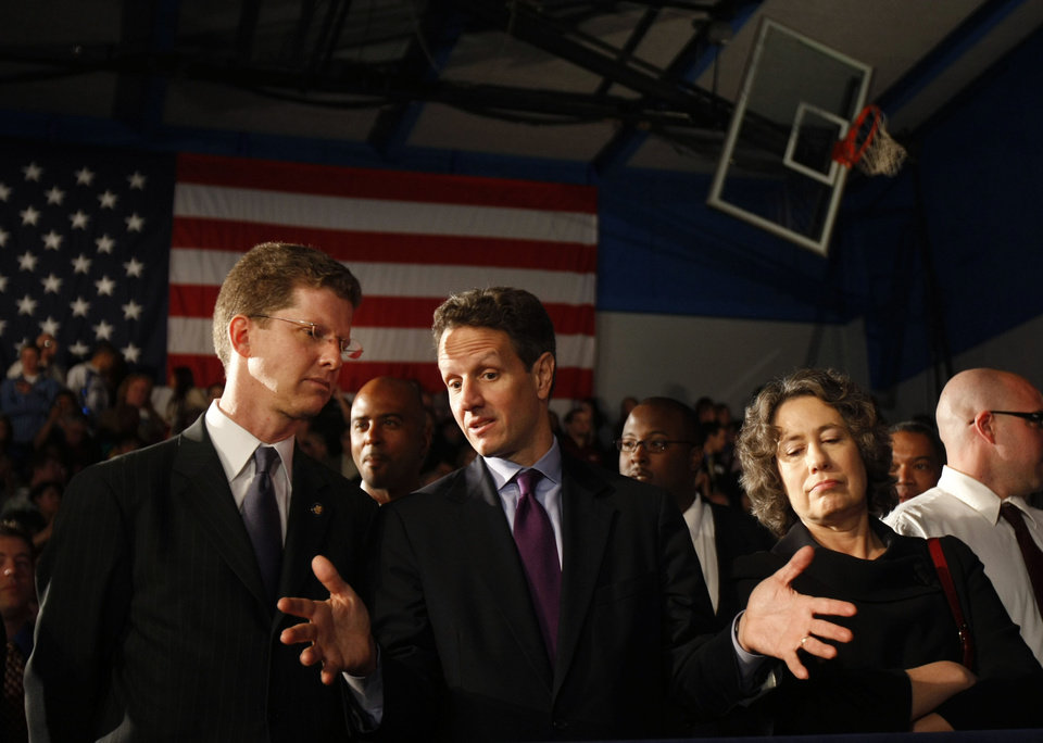 Photo - FILE - In this Wednesday, Feb. 18, 2009, file photo, from left, Housing and Urban Development Secretary Shaun Donovan, Treasury Secretary Timothy Geithner, and Federal Deposit Insurance Corporation (FDIC) Chair Sheila Bair talk prior to President Barack Obama delivering remarks about the home mortgage crisis, at Dobson High School in Mesa, Ariz. Under Geithner, Treasury fell far short of the administration's goals of helping up to 9 million homeowners at risk of losing homes to foreclosure.  Geithner's critics say he rejected suggestions that the programs require mortgage servicers to provide loan modifications. (AP Photo/Gerald Herbert)