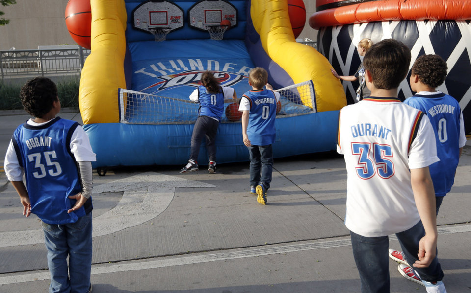 Photo - Fans play a basketball game before Game 5  in the first round of the NBA playoffs between the Oklahoma City Thunder and the Houston Rockets at Chesapeake Energy Arena in Oklahoma City, Wednesday, May 1, 2013. Photo by Sarah Phipps, The Oklahoman