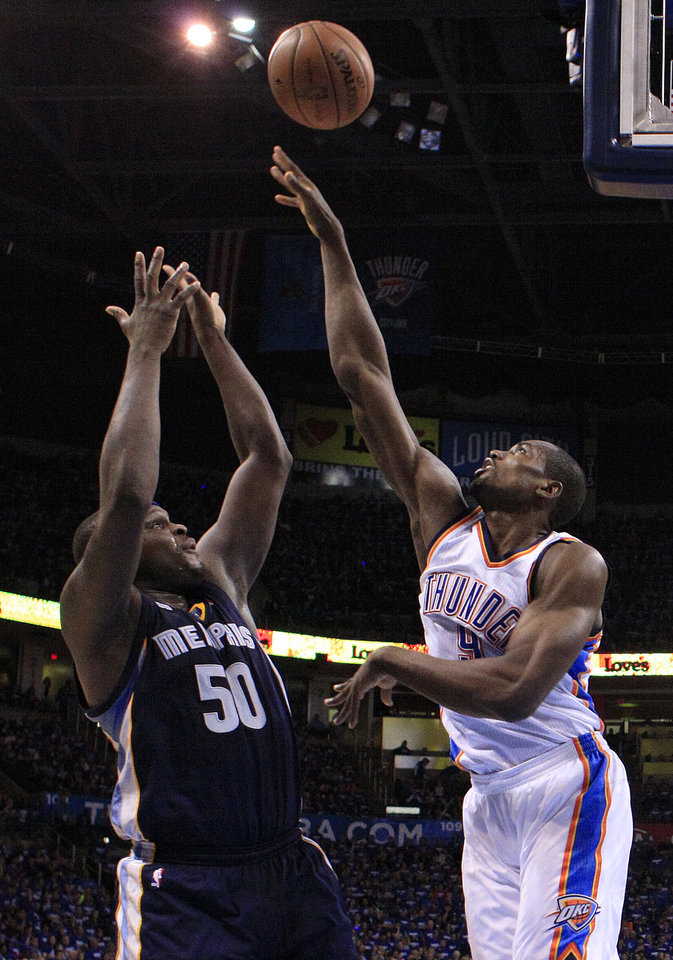 Photo - Oklahoma City's Serge Ibaka (9) defends against Memphis' Zach Randolph (50) during Game 1 in the second round of the NBA playoffs between the Oklahoma City Thunder and the Memphis Grizzlies at Chesapeake Energy Arena in Oklahoma City, Sunday, May 5, 2013. Photo by Sarah Phipps, The Oklahoman