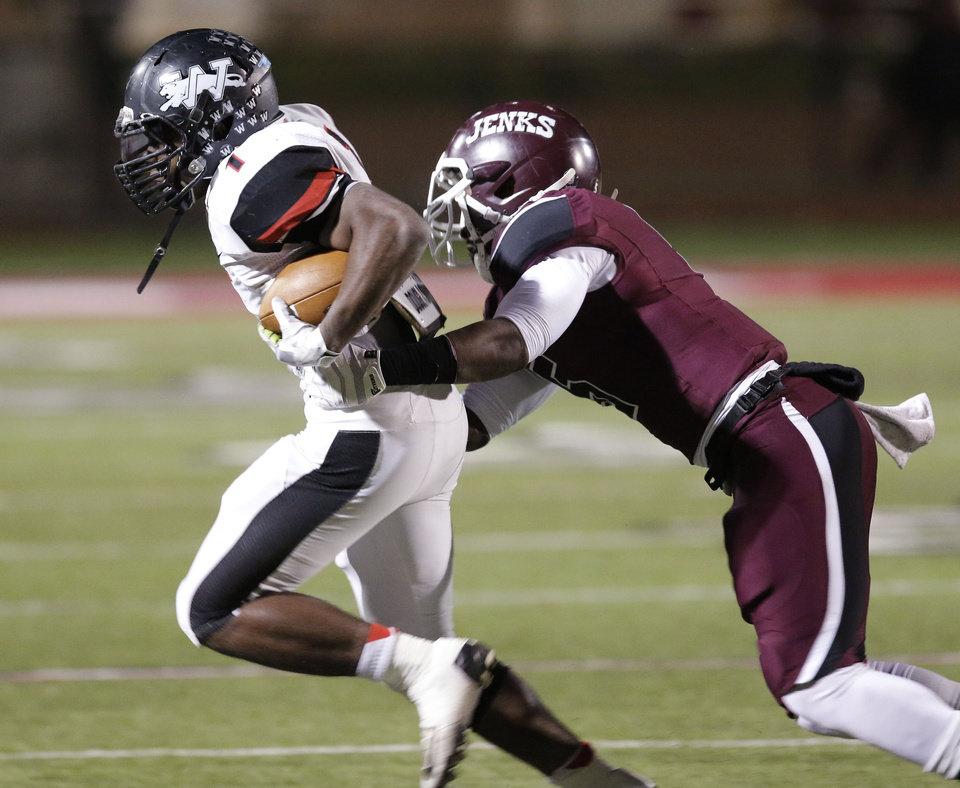 Photo - Westmoore's Kieron Hardick (1) gets run out of bounds during the 6A high school playoff game between Westmoore and Jenks at Yukon High School Friday November 29, 2013. Photo by Doug Hoke, The Oklahoman