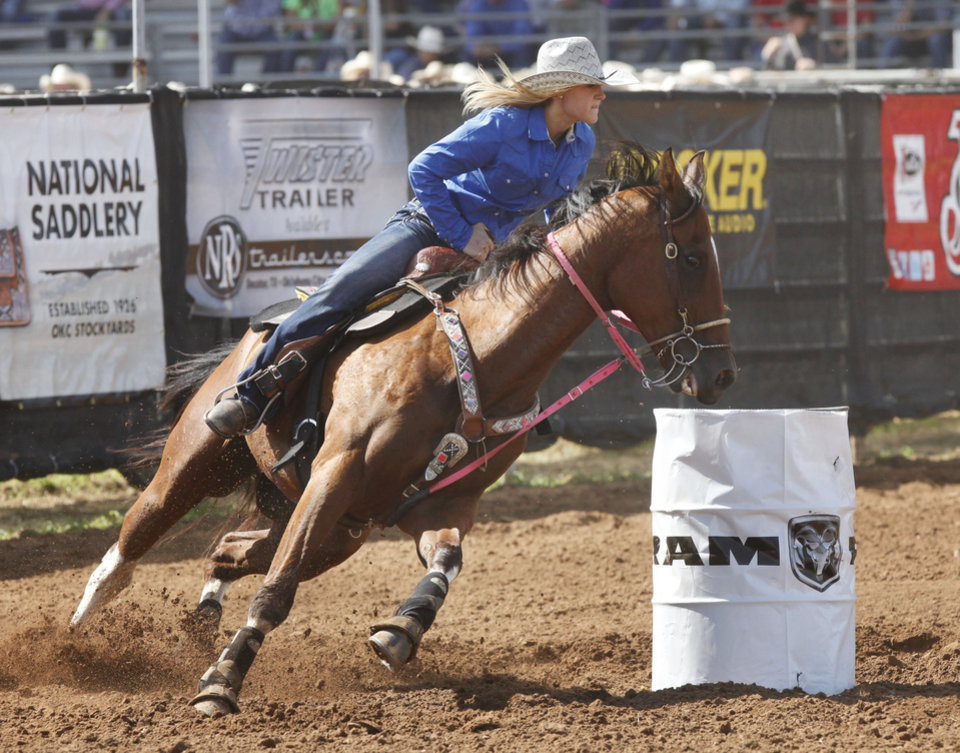 Photo - Sarah McClain, from Williamsville, MO, competes in the Barrel Racing event during Tuesday's performances at the International Youth Finals Rodeo at the Shawnee Heart of Oklahoma Exposition Center in Shawnee, OK, Tuesday, July 8, 2014,  Photo by Paul Hellstern, The Oklahoman