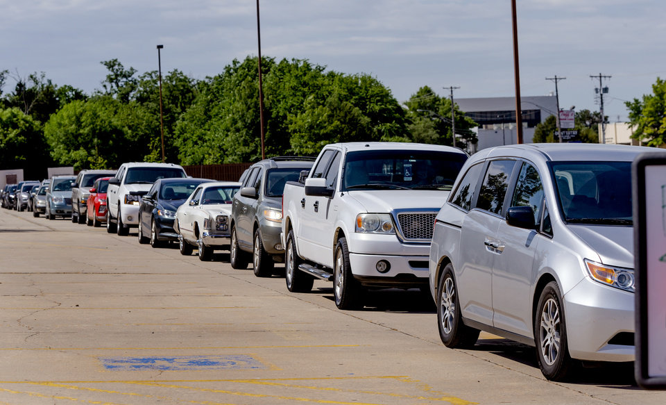 Photo - Traffic lines up for the Canadian County Health Department's Covid-19 drive thru Testing Event at Yukon Middle School on Wednesday, May 6, 2020, in Yukon, Okla. [Chris Landsberger/The Oklahoman]