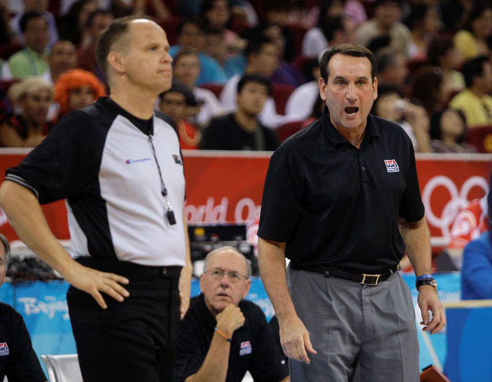 Photo - USA's coach Mike Krzyzewski, right, shouts instructions during the men's gold medal basketball game against Spain at the Beijing 2008 Olympics in Beijing, Sunday, Aug. 24, 2008.   (AP Photo/Dusan Vranic) ORG XMIT: OLY660