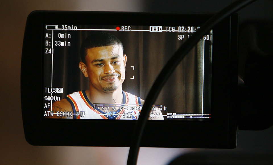 Photo - Earl Watson is shown on the screen of a video camera during media day for the Oklahoma City Thunder NBA basketball team at the Skirvin Hilton hotel in Oklahoma City, Monday, September 29, 2008. BY NATE BILLINGS, THE OKLAHOMAN. ORG XMIT: KOD