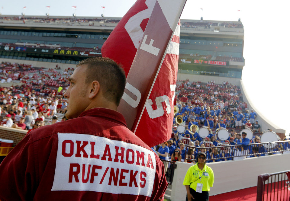 A member of the Oklahoma Ruf/Neks prepares for pre game during the college football game between the University of Oklahoma Sooners (OU) and the University of Tulsa Hurricanes (TU) at the Gaylord-Family Oklahoma Memorial Stadium on Saturday, Sept. 14, 2013 in Norman, Okla.  Photo by Chris Landsberger, The Oklahoman