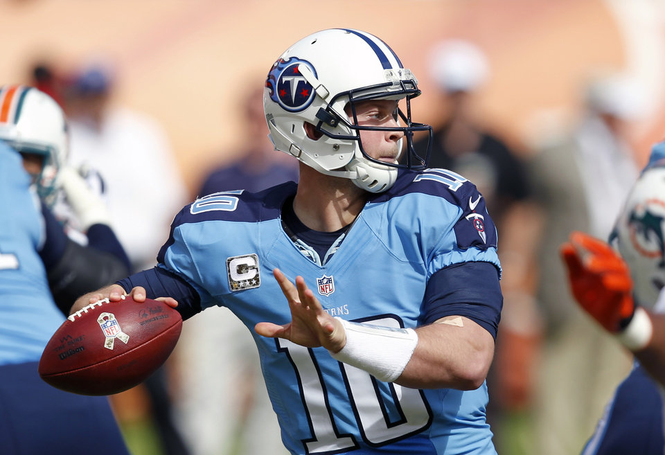 Photo -   Tennessee Titans quarterback Jake Locker throws a pass against the Miami Dolphins during the first half of an NFL football game, Sunday, Nov. 11, 2012, in Miami, Fla. (AP Photo/Wilfredo Lee)