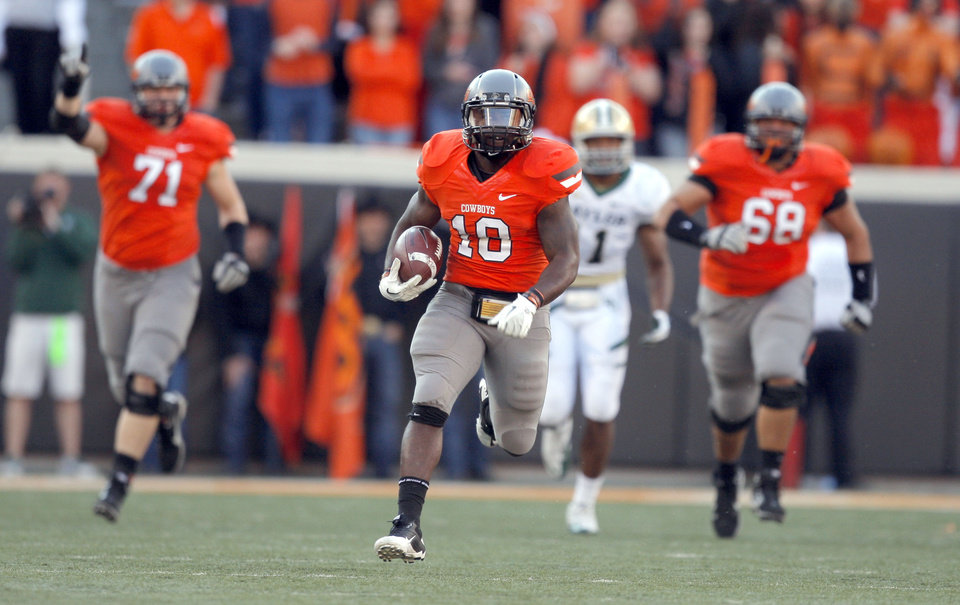 Photo - Oklahoma State's Herschel Sims (18) scores a touchdown during a college football game between the Oklahoma State University Cowboys (OSU) and the Baylor University Bears (BU) at Boone Pickens Stadium in Stillwater, Okla., Saturday, Oct. 29, 2011. Photo by Sarah Phipps, The Oklahoman