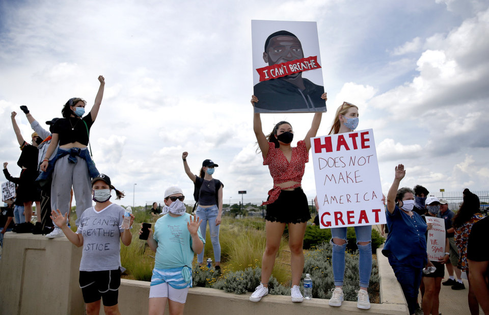 Photo - Protesters gather on the bridge on Main Street over 1-35 in Norman, Okla.  Tuesday, June 2, 2020.  [Sarah Phipps/The Oklahoman]