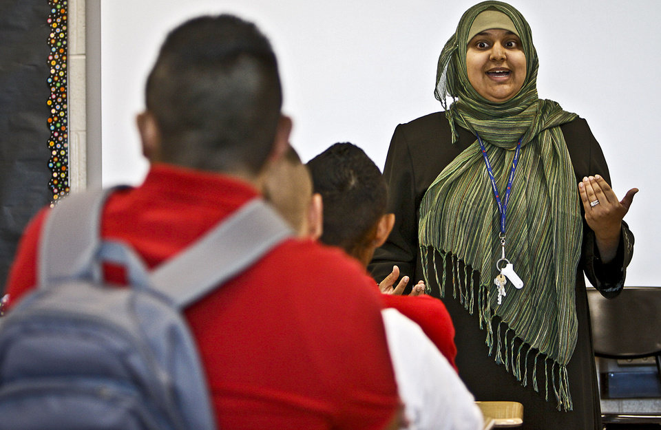 Photo - FIRST DAY OF SCHOOL: Hafsa Ishaq works with students on the first day of class at the new U.S. Grant High School on Thursday, Aug 19, 2010, in Oklahoma City, Okla. The school is undergoing the most drastic school improvement plan in the state while taking steps to replace fifty percent of the school's staff that was removed over the summer.   Photo by Chris Landsberger, The Oklahoman ORG XMIT: KOD