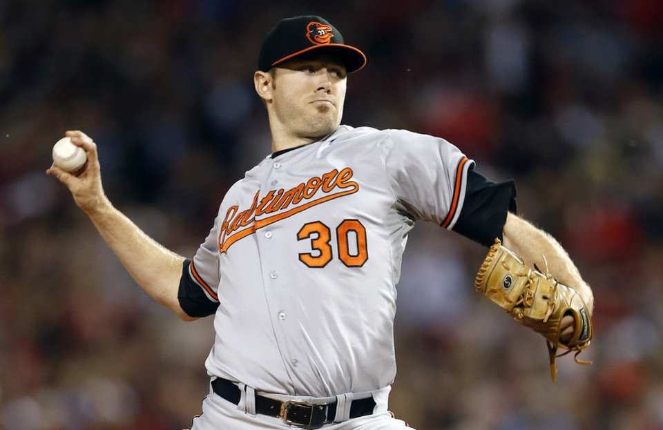 Photo - FILE - In this Sept. 19, 2013 file photo, Baltimore Orioles' Chris Tillman pitches in the first inning of a baseball game against the Boston Red Sox in Boston. Tillman finally put it all together last season, doubling his win total during a 16-7 year that probably earned him his first opening day start.  (AP Photo/Michael Dwyer, File)