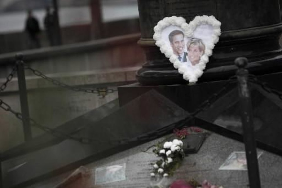 Photo - A picture of Britain's Prince William and his mother Princess Diana is seen at the memorial above the Alma underpass where she died on August 31, 1997, in Paris, Thursday, April 28, 2011. Prince William and Kate Middleton are due to get married on Friday, April 29. (AP Photo/Thibault Camus)