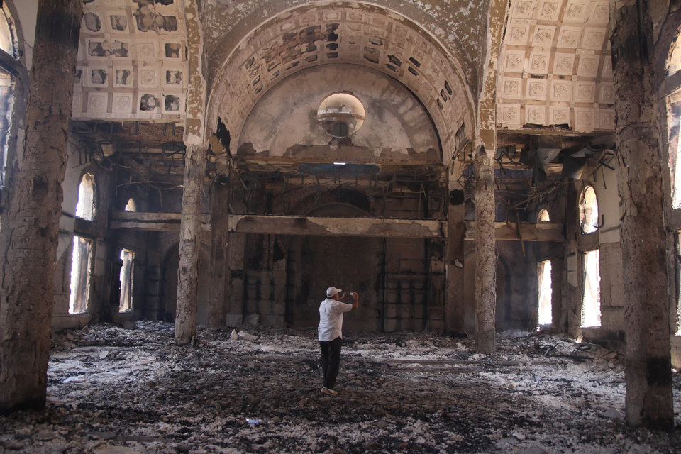 Photo - The damaged interior of the Saint Moussa Church is seen a day after it was torched in sectarian violence following the dispersal of two Cairo sit-ins of supporters of the ousted Islamist President Mohammed Morsi, in Minya, south of Cairo, Egypt, Thursday, Aug. 15, 2013. Egypt faced a new phase of uncertainty on Thursday after the bloodiest day since its Arab Spring began, with hundreds of people reported killed and thousands injured as police smashed two protest camps of supporters of the deposed Islamist president. Wednesday's raids touched off day-long street violence that prompted the military-backed interim leaders to impose a state of emergency and curfew, and drew widespread condemnation from the Muslim world and the West, including the United States. (AP Photo/Roger Anis, El Shorouk Newspaper) EGYPT OUT