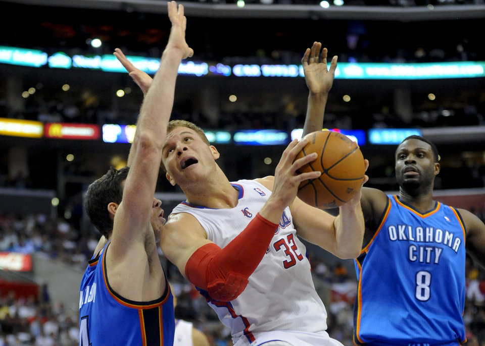 Oklahoma City Thunder forward Nick Collison, left, and center Nazr Mohammed (8) double team Los Angeles Clippers forward Blake Griffin (32)  in the first half of an NBA basketball game, Monday, April 16, 2012, in Los Angeles. (AP Photo/Gus Ruelas) ORG XMIT: LAS101