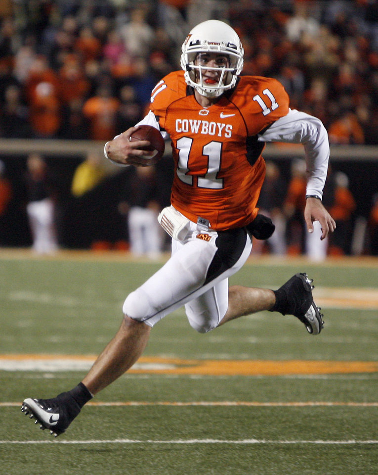 Photo - OSU's Zac Robinson (11) scrambles during the second half of the college football game between Oklahoma State University (OSU) and Texas Tech University at Boone Pickens Stadium in Stillwater, Okla. Saturday, Nov. 14, 2009. Photo by Sarah Phipps, The Oklahoman