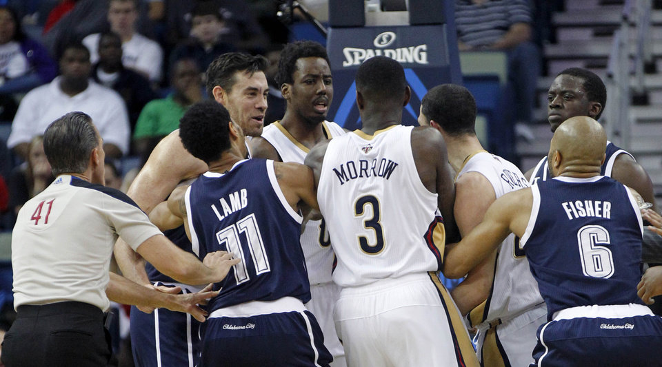 Oklahoma City Thunder forward Nick Collison, left, and New Orleans Pelicans guard Austin Rivers, third right, get into a scuffle in the first half of an NBA basketball game in New Orleans, Monday, April 14, 2014. Both were ejected from the game. (AP Photo/Gerald Herbert)