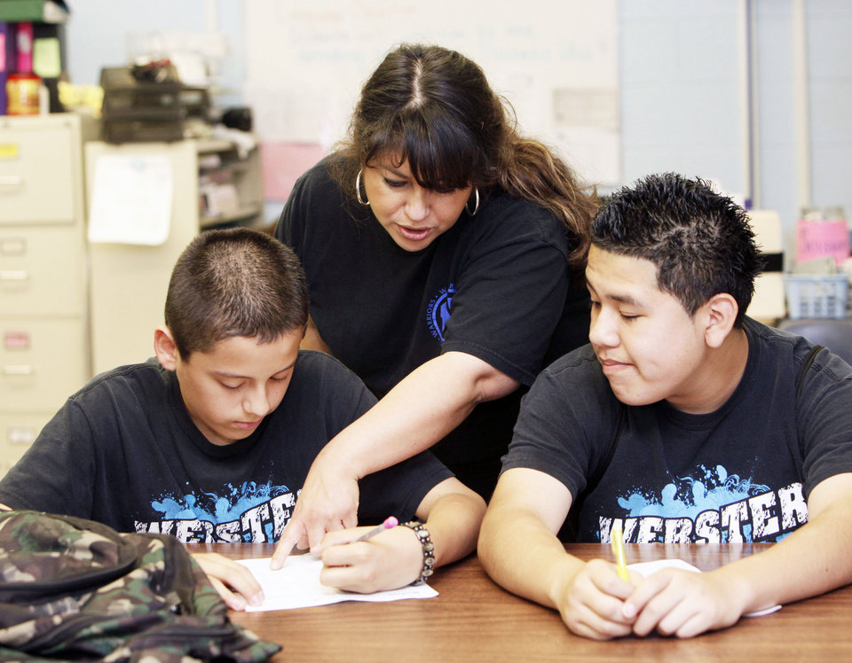 Photo - ESL instructor works with students at Webster Middle School in Oklahoma City, OK, Friday, May 4, 2012. This is for a story about the life of a middle school.  By Paul Hellstern, The Oklahoman
