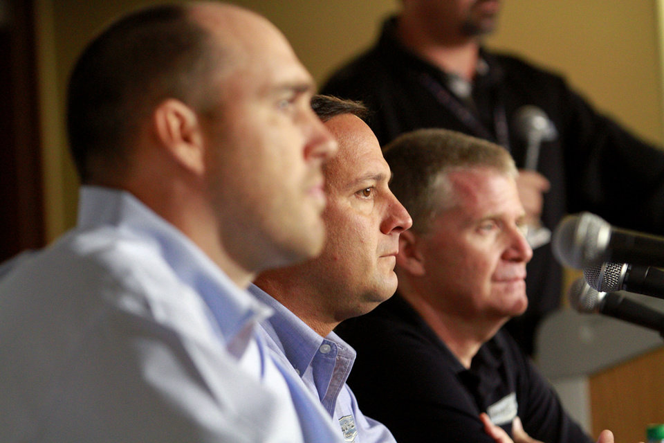 Photo - Stewart-Haas Racing executive vice president Brett Frood, left, crew chief Greg Zipadelli, center, and driver Jeff Burton are shown during a news conference at Michigan International Speedway in Brooklyn, Mich., Friday, Aug. 15, 2014. Tony Stewart will not race Sunday at Michigan International Speedway, skipping a second straight NASCAR Sprint Cup race since striking and killing a driver in a dirt-track race at a small New York track. Jeff Burton will drive Stewart's No. 14 Chevrolet in Michigan. (AP Photo/The Jackson Citizen Patriot, Brian Smith) ALL LOCAL TELEVISION OUT; ALL LOCAL INTERNET OUT