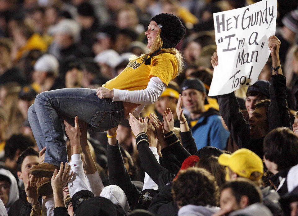 Photo - A Colorado fan is tossed in the air in the second half during the college football game between Oklahoma State University and University of Colorado at Folsom Field in Boulder, Colo., Saturday, Nov. 15, 2008. OSU won, 30-17. BY NATE BILLINGS, THE OKLAHOMAN