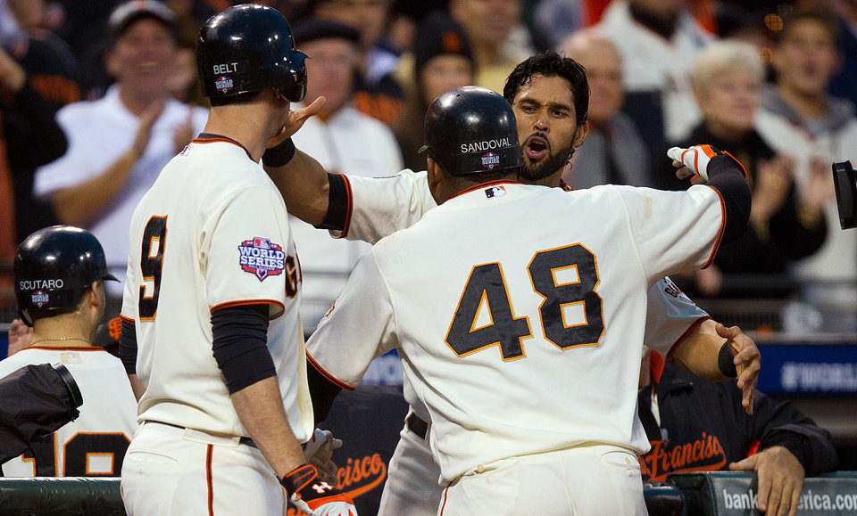 Photo -   San Francisco Giants' Pablo Sandoval (48) celebrates with teammates at the dugout after hitting a home run against the Detroit Tigers during the fifth inning of Game 1 of baseball's World Series, Wednesday, Oct. 24, 2012, in San Francisco. (AP Photo/The Sacramento Bee, Jose Luis Villegas) MAGS OUT; LOCAL TV OUT (KCRA3, KXTV10, KOVR13, KUVS19, KMAZ31, KTXL40); MANDATORY CREDIT