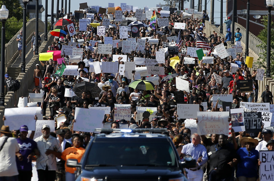 Photo -  A crowd marches across the G.E. Finley Bridge during a protest July 10, 2016, led by Black Lives Matter Oklahoma in Bricktown in Oklahoma City. [Photo by Bryan Terry, The Oklahoman Archives]