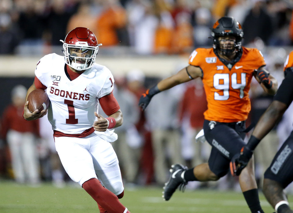 Photo - Oklahoma's Jalen Hurts (1) rushes for a touchdown at Oklahoma State's Trace Ford (94) chases him in the first quarter during the Bedlam college football game between the Oklahoma State Cowboys (OSU) and Oklahoma Sooners (OU) at Boone Pickens Stadium in Stillwater, Okla., Saturday, Nov. 30, 2019. [Sarah Phipps/The Oklahoman]