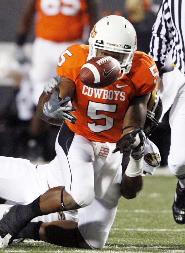 Photo - Keith Toston fumbles and recovers the ball during the first half of the college football game between Oklahoma State University (OSU) and the University of Missouri (MU) at Boone Pickens Stadium in Stillwater, Okla. Saturday, Oct. 17, 2009.  Photo by Steve Sisney, The Oklahoman