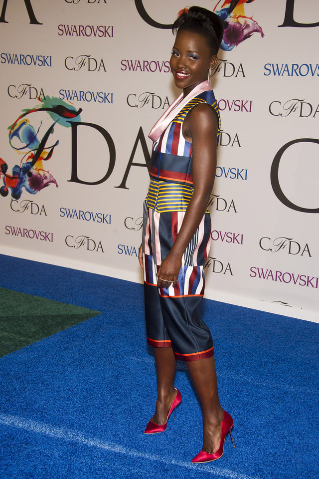 Photo - Lupita Nyong'o attends the CFDA Fashion Awards on Monday, June 2, 2014 in New York. (Photo by Charles Sykes/Invision/AP)