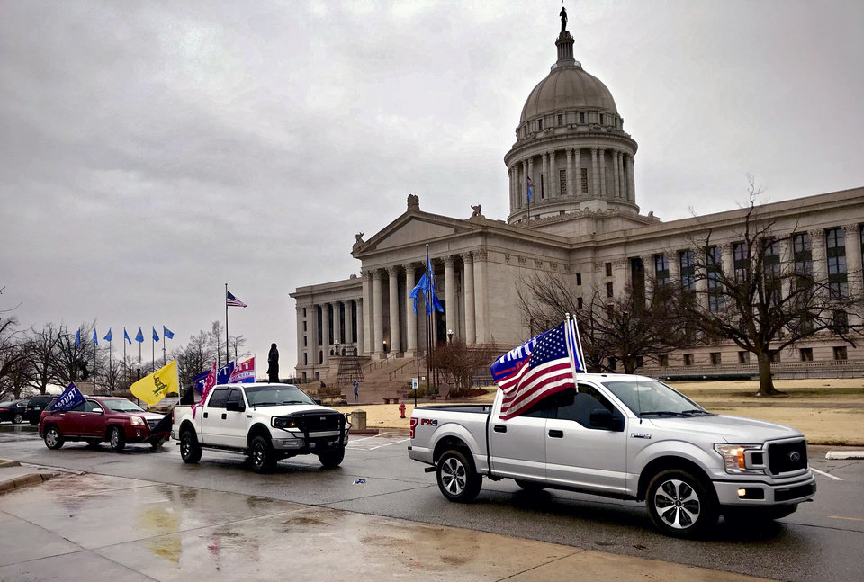Photo - Supporters leave the Oklahoma state Capitol after taking part in the Drive for 45 Rally to support the Pres. Donald Trump in Oklahoma City, Okla. on Wednesday, Jan. 6, 2021. [Chris Landsberger/The Oklahoman]