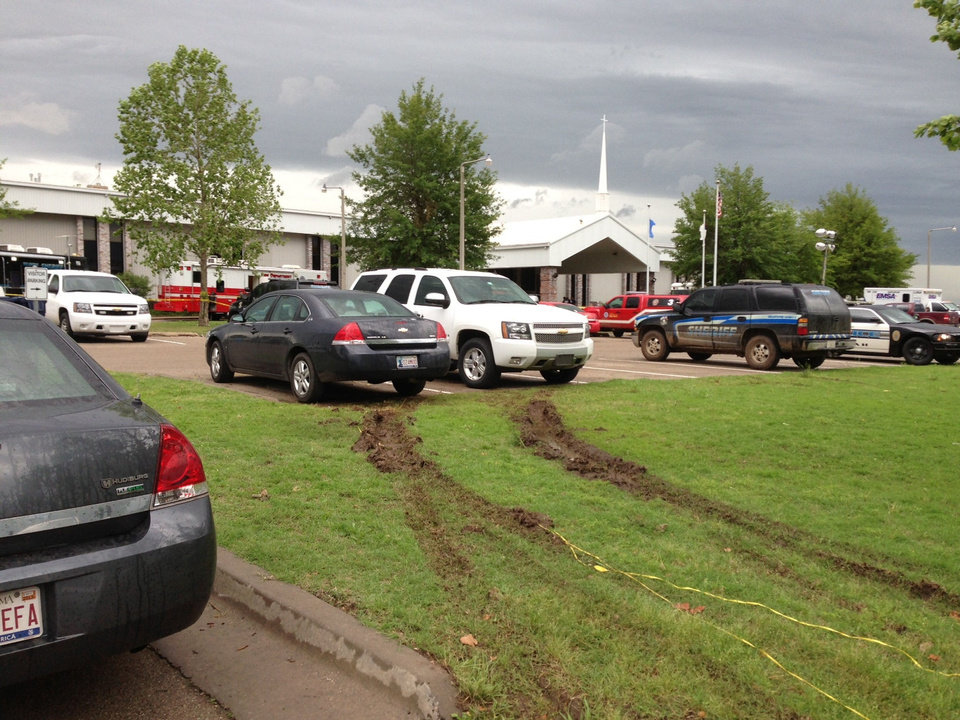 Photo - Emergency vehicles filled The Rock Assembly's parking lot after the May 20 tornado. The church acted as Oklahoma City's disaster relief command center.  PHOTO PROVIDED BY JOHN GIFFORD - The Rock Assembly