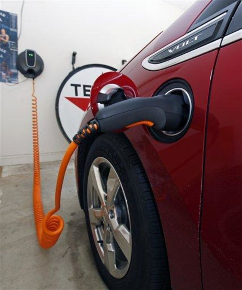 This Friday, March 25, 2011 photo shows James Brazell\'s Chevy Volt electric car as it charges in the garage at his home in Asheville, N.C. Brazell plugs the car in after short trips.
