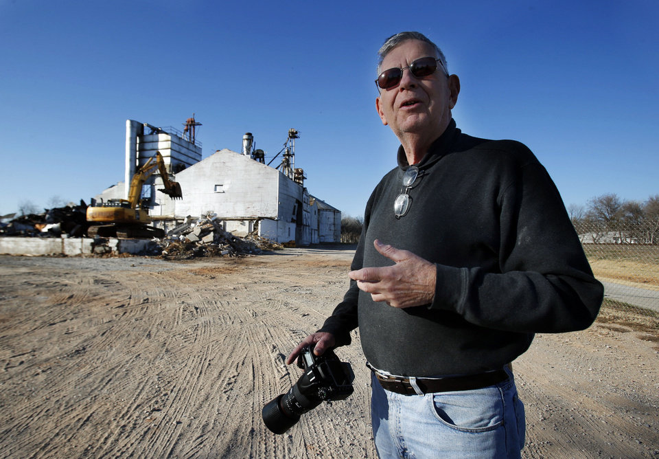Photo - Longtime mill employee Richard McDonald documents with a camera the demolition of the Rhodes Granary, north of Andrews Park in Norman. PHOTOS BY STEVE SISNEY, THE OKLAHOMAN