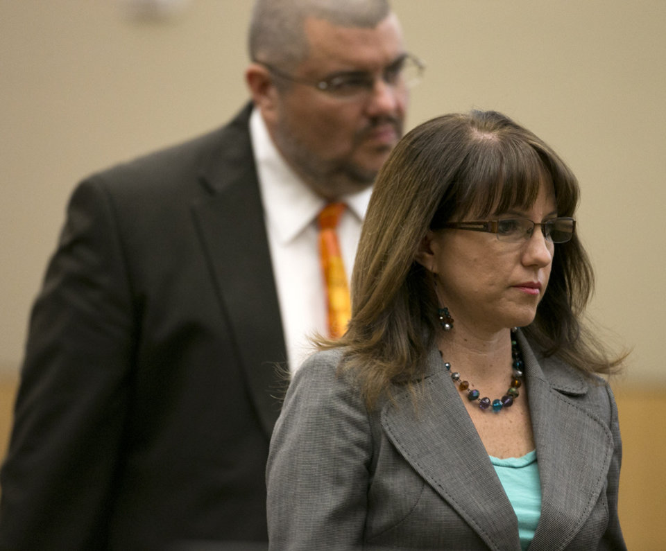 Photo - Defense attorneys Kirk Nurmi and Jennifer Wilmott during the Jodi Arias trial at Maricopa County Superior Court in Phoenix on Tuesday, April 16, 2013. Defense attorneys rested their case Tuesday after about 2 1/2 months of testimony aimed at portraying Arias as a domestic violence victim who fought for her life the day she killed her one-time boyfriend. (AP Photo/The Arizona Republic, David Wallace, Pool)