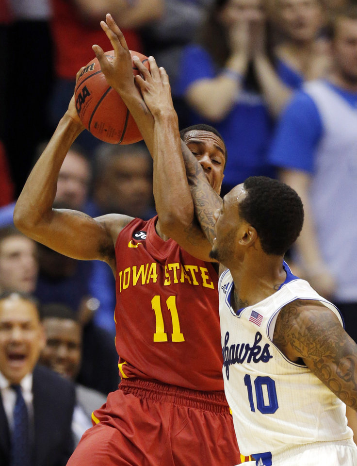 Photo - Iowa State guard Monte Morris (11) is fouled by Kansas guard Naadir Tharpe (10) during the first half of an NCAA college basketball game in Lawrence, Kan., Wednesday, Jan. 29, 2014. (AP Photo/Orlin Wagner)