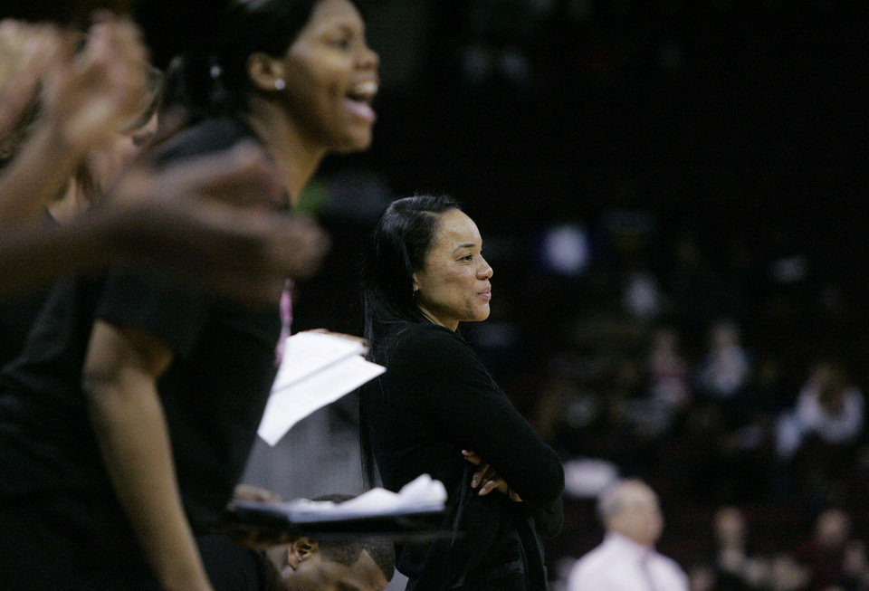 Photo - South Carolina Dawn Staley looks on as her team rack up the points during the second half of their NCAA college basketball game against Arkansas, Sunday Feb. 9, 2014, in Columbia, SC. South Carolina defeated 67-49. (AP Photo/Mary Ann Chastain)