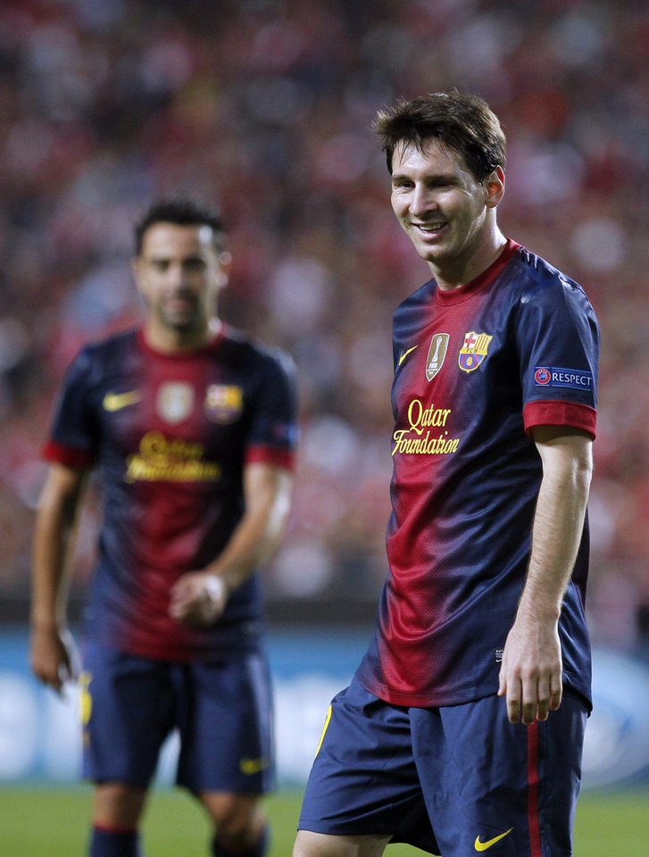 Photo -   Barcelona's Lionel Messi, from Argentina, reacts during their Champions League group G soccer match against Benfica at Benfica's Luz stadium in Lisbon, Tuesday, Oct. 2, 2012. Barcelona defeated Benfica 2-0. (AP Photo/Francisco Seco)