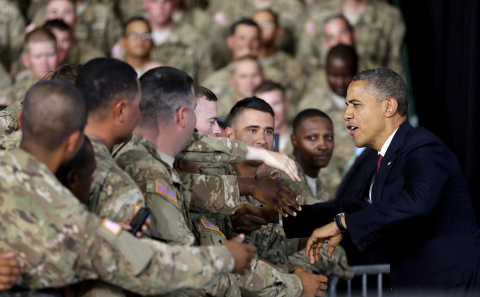 Photo -   President Barack Obama greets members of the military and their families at Fort Bliss, Friday, Aug. 31, 2012, in El Paso, Texas. (AP Photo/Pablo Martinez Monsivais)