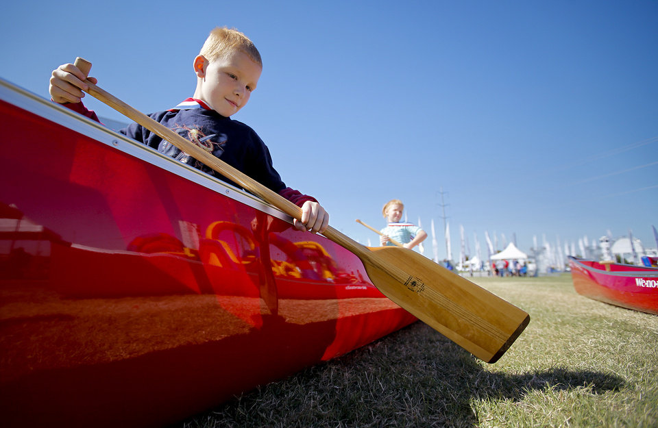Joshua Cleary, 9, of Choctaw, tries his best to make the canoe move while taking part in the fan fest area during the Oklahoma Regatta Festival at the Oklahoma River on Saturday, Oct. 1, 2011, in Oklahoma City, Okla. Photo by Chris Landsberger, The Oklahoman