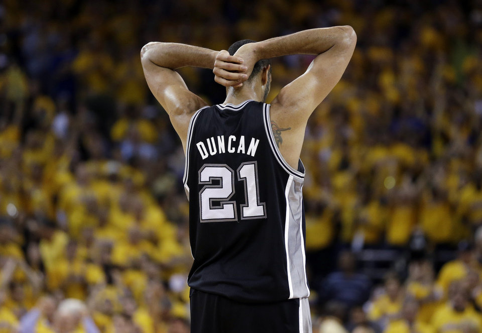 Photo - San Antonio Spurs power forward Tim Duncan (21) reacts to a call in the second half against the Golden State Warriors in Game 6 of a Western Conference semifinal NBA basketball playoff series in Oakland, Calif., Thursday, May 16, 2013. (AP Photo/Marcio Jose Sanchez)