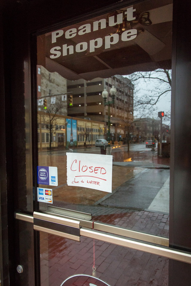 Photo - Restaurants and stores in Charleston, W.Va. are closed Saturday, Jan. 11, 2014 following the chemical spill on Thursday. Restaurants and business were asked to not use tap water for drinking or washing hands until further notice. (AP Photo Michael Switzer)